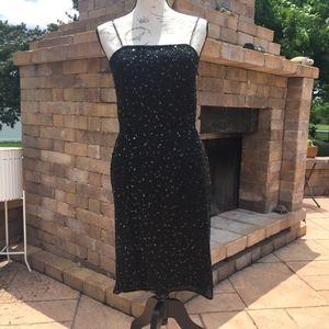 Dresses & Skirts - Black sleeveless sequin mini dress - size small